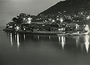 Asano Kiichi<br /> 1914 - 1993<br /> <br /> View of Tomo no Ura, Hiroshima Prefecture, 1950s. <br /> <br /> Vintage gelatin silver print that has on the reverse; Asano's blue studio and red hanko stamps, as well as a caption inscription in the artist's hand.<br /> <br /> Size 6 1/2 in. x 4 3/4 in. (165 mm x 120 mm). <br /> <br /> Condition very good.<br /> <br /> Price ¥90,000<br /> <br /> <br /> <br /> <br /> <br /> <br /> <br /> <br /> <br /> <br /> <br /> <br /> <br /> <br /> <br /> <br /> <br /> <br /> <br /> <br /> <br /> <br /> <br /> <br /> <br /> <br /> .