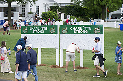 May 5, 2019 - Charlotte, North Carolina, United States of America - Patrons sign a ''Charlotte Strong'' sign during the final round of the 2019 Wells Fargo Championship at Quail Hollow Club on May 05, 2019 in Charlotte, North Carolina, following a shooting at UNC-Charlotte earlier in the week. (Credit Image: © Spencer Lee/ZUMA Wire)