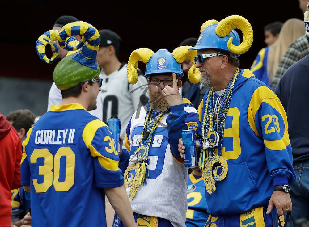 Los Angeles Rams fans pose before an NFL football game against the Atlanta Falcons Sunday, Dec. 11, 2016, in Los Angeles. (AP Photo/Rick Scuteri)