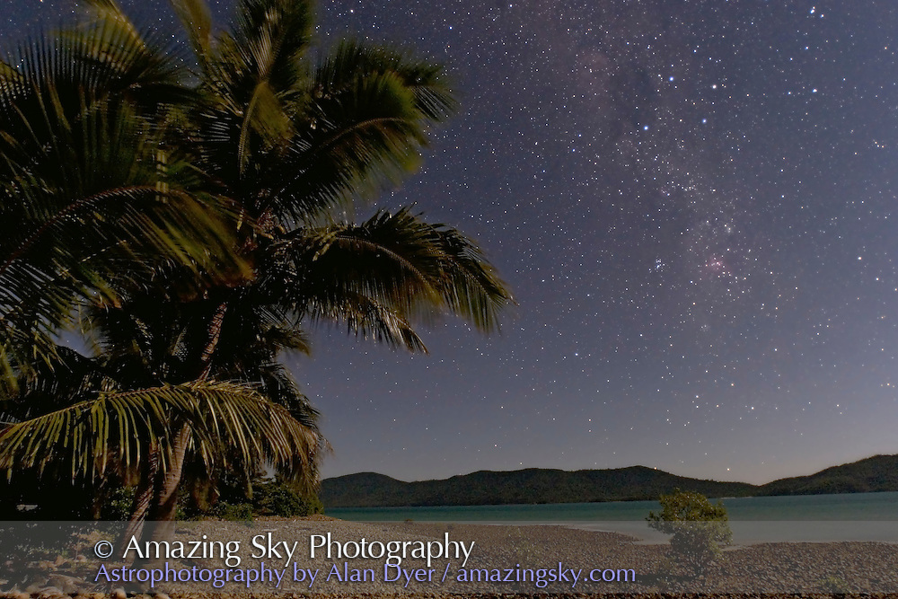 Carina and Crux setting over Australian mainland, as seen from Long Island in Whitsundays in Queensland coast. Canon 20Da camera with 16-35mm L lens at 16mm and f/2.8 and ISO 800 for 30 seconds. Taken July 4, 2006. Waxing gibbous Moon provides the illumination. Glows added to stars in Photoshop.