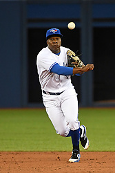 March 30, 2018 - Toronto, ON, U.S. - TORONTO, ON - MARCH 30: Toronto Blue Jays Infield Gift Ngoepe (61) throws over to first base during the regular season MLB game between the New York Yankees and Toronto Blue Jays on March 30, 2018 at Rogers Centre in Toronto, ON. (Photo by Gerry Angus/Icon Sportswire) (Credit Image: © Gerry Angus/Icon SMI via ZUMA Press)