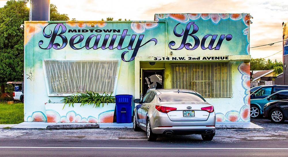 Beauty salon in a mural covered Miami Modern building in Miami's Buena Vista West neghborhood