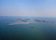 Nederland, Flevoland, Markermeer, 26-08-2019; Marker Wadden in het Markermeer. Boordkust met werkschepen.<br /> Doel van het project van Natuurmonumenten en Rijkswaterstaat is natuurherstel, met name verbetering van de ecologie in het gebied, in het bijzonder de kwaliteit van bodem en water<br /> Naast het hoofdeiland is er inmiddels een tweede eiland in wording, de uiteindelijk Marker Wadden archipel zal uit vijf eilanden bestaan. <br /> Marker Wadden, artifial islands. The aim of the project is to restore the ecology in the area, in particular the quality of soil and water.<br /> The first phase of the construction, the main island, is finished. <br /> <br /> luchtfoto (toeslag op standard tarieven);<br /> aerial photo (additional fee required);<br /> copyright foto/photo Siebe Swart