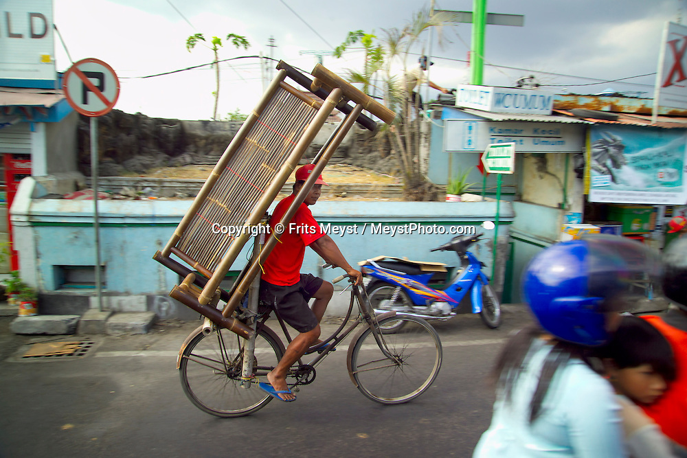 Yogyakarta, Java, Indonesia, October 2006. A rickshaw transports a big cupboard. The island of Java is rich with culture, colorful friendly people, dutch colonial history and beautiful landscapes. Photo by Frits Meyst/Adventure4ever.com