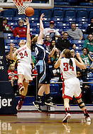 UD freshman Andrea Hoover (24) and UD senior Justine Raterman (34) go for a rebound as the Rhode Island Rams play the University of Dayton Flyers at UD Arena in Dayton, Saturday, January 7, 2012.