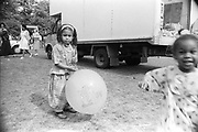 Young girl holding balloon, Moss Side Carnival, Alexandra Park, Manchester 1989