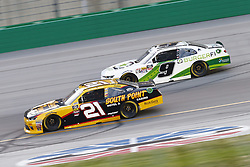 July 13, 2018 - Sparta, Kentucky, United States of America - Daniel Hemric (21) and Tyler Reddick (9) battle for position during the Alsco 300 at Kentucky Speedway in Sparta, Kentucky. (Credit Image: © Chris Owens Asp Inc/ASP via ZUMA Wire)