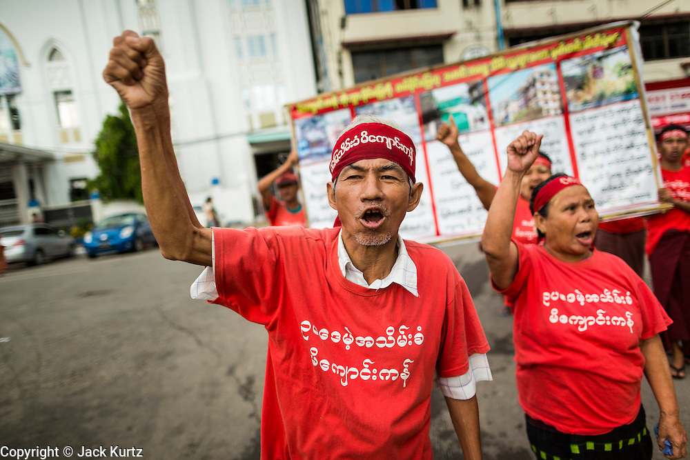 07 JUNE 2014 - YANGON, MYANMAR: Burmese peasants march in Yangon. About 100 Burmese citizens who say they've lost their land to the Burmese army, had a protest march in central Yangon Saturday. It's a sign of how quickly Myanmar is changing that authorities allowed the march, and other protests like it, to proceed without interference.  PHOTO BY JACK KURTZ