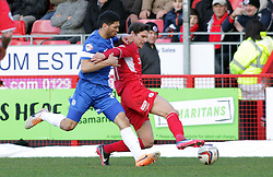Peterborough United's Nat Knight-Percival in action with Crawley Town's Josh Simpson - Photo mandatory by-line: Joe Dent/JMP - Tel: Mobile: 07966 386802 01/03/2014 - SPORT - FOOTBALL - Crawley - Broadfield Stadium - Crawley Town v Peterborough United - Sky Bet League One
