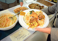 A guest fills a plate with some of the cuisine during the 15th annual international dinner Saturday October 17, 2015 at St. Elizabeth Ann Seton in Bensalem, Pennsylvania.  (Photo by William Thomas Cain)