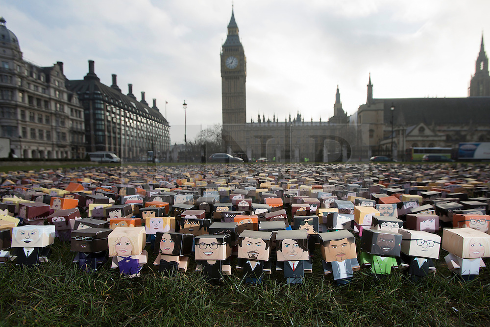 © licensed to London News Pictures. 04/03/2013. London, UK. Photocall for 6,000 personalised cardboard characters placed on Parliament square, London, in front of the houses of Parliament as part of the Fairtrade Foundation's campaign for a better deal for<br /> small farmers. The 'mini marchers', which include characters of celebrities such as  Jonathan Ross, Eddie Izzard and Tulisa, call for David Cameron to do more for small holder farmers ahead of the G8 summit in June 2013. Photo credit: Tolga Akmen/LNP