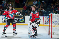 KELOWNA, CANADA - OCTOBER 11:   Riley Stadel #3 comes to the aid of Jordon Cooke #30 of the Kelowna Rockets after members of the Seattle Thunderbirds knock off Cooke's helmet on October 11, 2013 at Prospera Place in Kelowna, British Columbia, Canada (Photo by Marissa Baecker/Shoot the Breeze) *** Local Caption ***