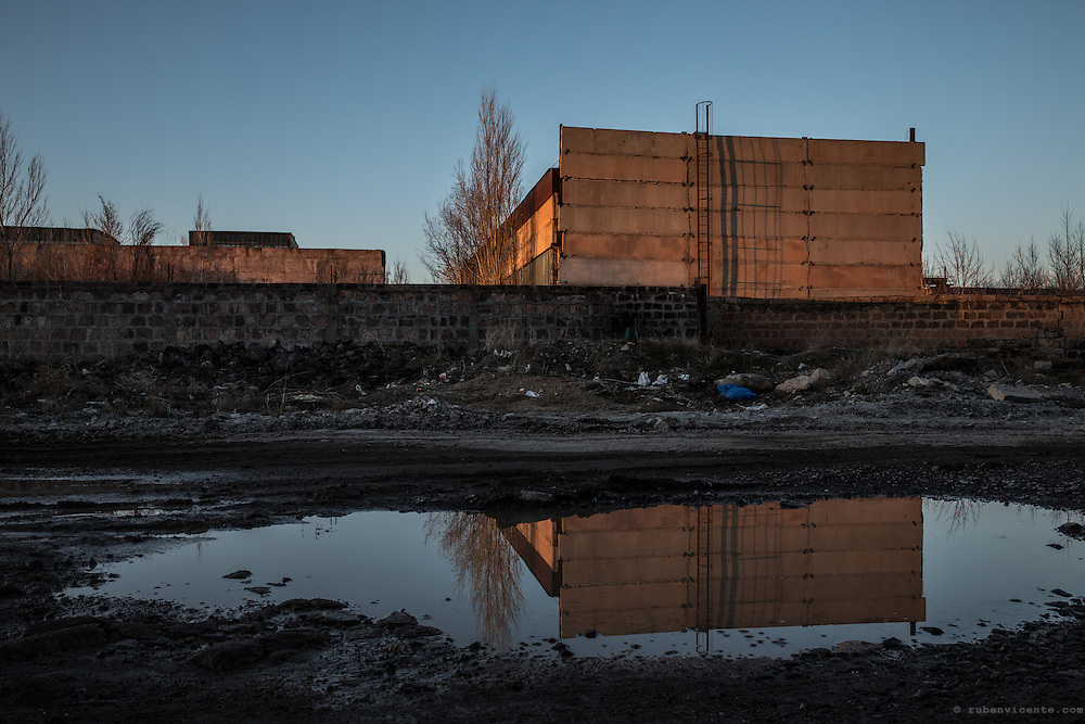 Factory reflection in a pond. Gyumri, Armenia