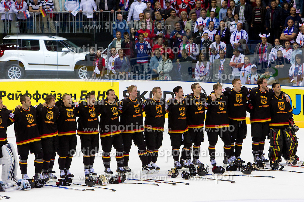 Players of Germany listening to the national anthem after the ice-hockey match between Germany and Russia of Group A of IIHF 2011 World Championship Slovakia, on April 29, 2011 in Orange Arena, Bratislava, Slovakia. Germany defeated Russia 2-0. (Photo By Vid Ponikvar / Sportida.com)