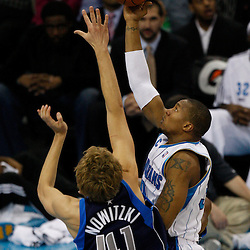 Mar 22, 2010; New Orleans, LA, USA; New Orleans Hornets forward David West (30) shoots over Dallas Mavericks forward Dirk Nowitzki (41) during the first half at the New Orleans Arena. Mandatory Credit: Derick E. Hingle-US PRESSWIRE