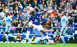 Everton's Romelu Lukaku is tackled by Manchester City captain, Vincent Company  - Mandatory byline: Matt McNulty/JMP - 07966386802 - 23/08/2015 - FOOTBALL - Goodison Park -Everton,England - Everton v Manchester City - Barclays Premier League