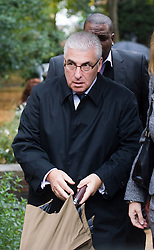 © Licensed to London News Pictures. 26/10/2011. London, UK. L to R Mitch Winehouse  arriving at St Pancras Coroners Court in London  today (26/10/2011) for the inquest in to the death of singer Amy Winehouse.  Photo credit: Ben Cawthra/LNP