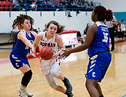 Norman's Myka Perry driving past Choctaw's Makayla White and Avery Clark on during their game on Saturday, March 02, 2019 at Western Heights.