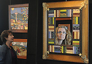 DOYLESTOWN, PA - MAY 17:  Suzanne Dunleavy (R), 48 of Doylestown, Pennsylvania is reflected in a mirror at the Tile Festival at Moravian Pottery and Tile Works May 17, 2014 in Doylestown, Pennsylvania. The festival is a two-day show and sale of handcrafted contemporary and historic decorative tiles and mosaics by tile artisans and vendors. (Photo by William Thomas Cain/Cain Images)