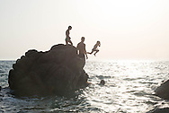 Corsica, Propriano area, Arena Bianca beach. young people and children diving in the mediterranean sea at sunset,/ des jeunes plongent dans la mer au coucher du soleil en Corse