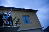 """A young man """"on top of the World"""" at a balcony during a High School graduation party in Steinkjer, Norway"""