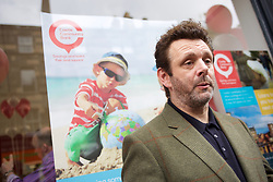 Actor and social campaigner Michael Sheen in Leith to open a branch of Castle Community bank, pictured with Rev Iain May the bank's chairman pic copyright Terry Murden @edinburghelitemedia