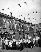 1953 street party in England to celebrate  the Coronation of Queen Elizabeth II