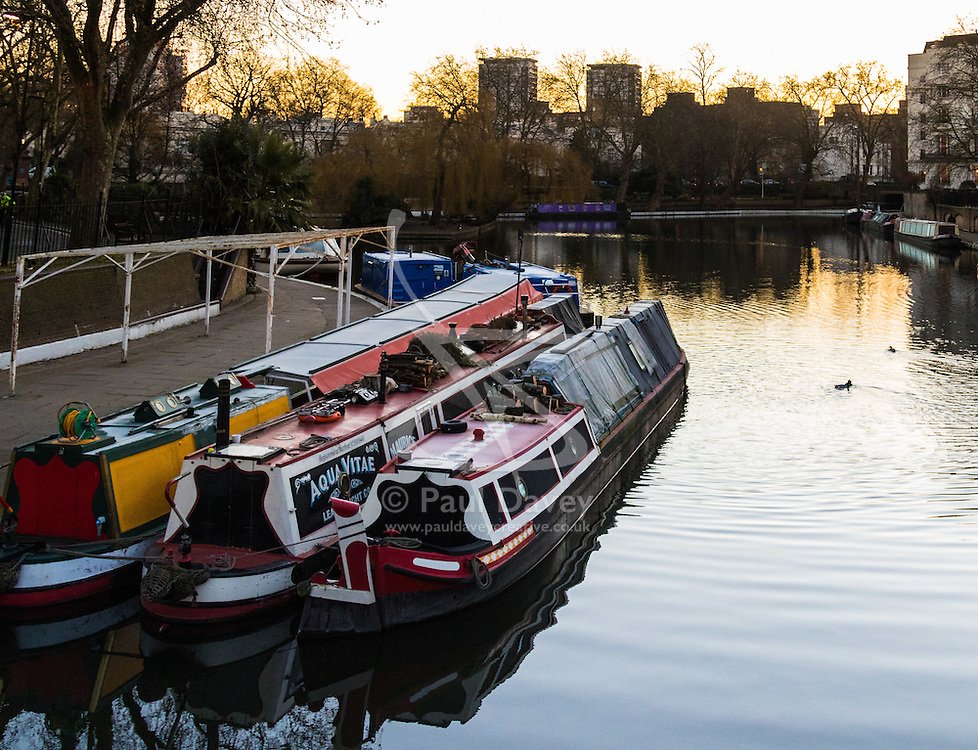 Little Venice, London, February 19th 2016. Narrowboats create reflections in the ripples at the junction of the Regent's and Grand Union Canals as the sun rises on a clear, cold February morning. ©Paul Davey<br /> FOR LICENCING CONTACT: Paul Davey +44 (0) 7966 016 296 paul@pauldaveycreative.co.uk