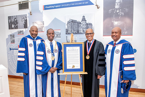 Chairman of the Board Stacey Mobley, President Wayne A.I. Frederick, honoree Dr. Michael Winston, and a trustee with a Commencement citation.