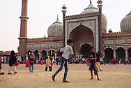 The large, square courtyard of one of India's largest mosques during a hot Summer Sunday