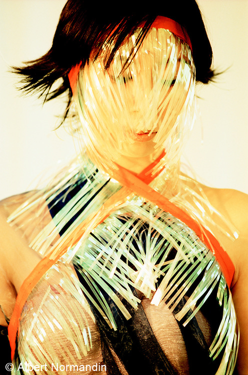 Portrait of woman covered in plastic trimmings
