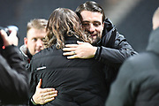 Milton Keynes Dons manager Russell Martin  hugs Wycombe Wanderers manager Gareth Ainsworth  during the EFL Trophy match between Milton Keynes Dons and Wycombe Wanderers at stadium:mk, Milton Keynes, England on 12 November 2019.