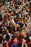 Crowd dancing in the street at Norman Jay's Good Times sound system Notting Hill Carnival London 2003