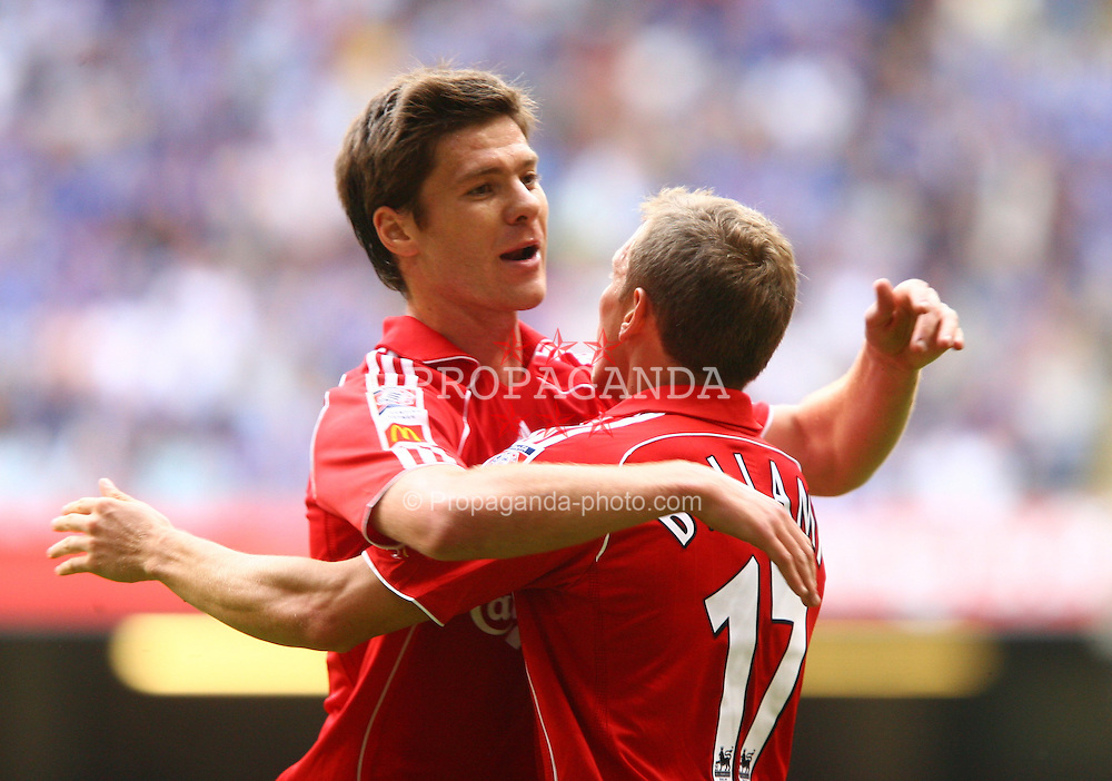 CARDIFF, WALES - SUNDAY, AUGUST 13th, 2006: Liverpool's Xabi Alonso and Craig Bellamy celebrate second goal scored by Peter Crouch during the Community Shield match  against Chelsea at the Millennium Stadium. (Pic by David Rawcliffe/Propaganda)