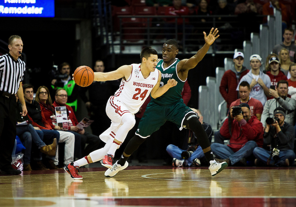UW-Green bay guard Khalil Small (3) defends UW guard Bronson Koenig (24) during the first half of the UW-Green Bay Men's Basketball game versus University of Wisconsin at the Kohl Center, Wednesday, December 14, 2016.