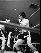Nash vs Leon Championship Fight.    (N55)..1980..14.12.1980..12.14.1980..14th December 1980..At the Burlington Hotel, Dublin, Charlie Nash defended his European Lightweight Title when he took on Spain's Francesco Leon. .Image shows leon trying to get out of the corner as Nash drives his advantage home.