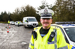 Pictured: Inspector Roddie MacMillan<br /> <br /> Police Scotland luanched a series of vehicle checks to be carried out by the Lothians and Scottish Borders Division Road Policing Unit. Inspector Roddie MacMillan oversaw the checks which are part of activity taking place across Scotland this week to help drivers get ready for winter, ensuring their vehicles are maintained and they are aware of the different hazards the changing seasons and weather can bring. <br /> <br /> Ger Harley | EEm 18 October 2016