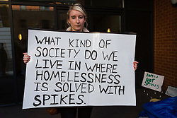 © Licensed to London News Pictures. 10/06/2014. London, UK. Founder of the 'Homes not spikes' petition, Harriet Wells protests outside 118 Southwark Bridge Road in South East London, where controversial inch high metal spikes have been installed outside a luxury block of London flats to deter homeless people from sleeping in the doorway. Photo credit : Vickie Flores/LNP