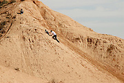 Israel, Negev plains, Nitzana father helps child crawl up a sand dune