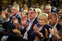 © Licensed to London News Pictures.  19/07/2014. Milton Keynes, UK. Labour party members including shadow chancellor Ed Balls (centre) listen to a speech by leader Ed Miliband (not seen) at the 2014 National Policy Forum (NPF) being held at the Kents Hill Training Centre in Milton Keynes. Photo credit: Cliff Hide/LNP