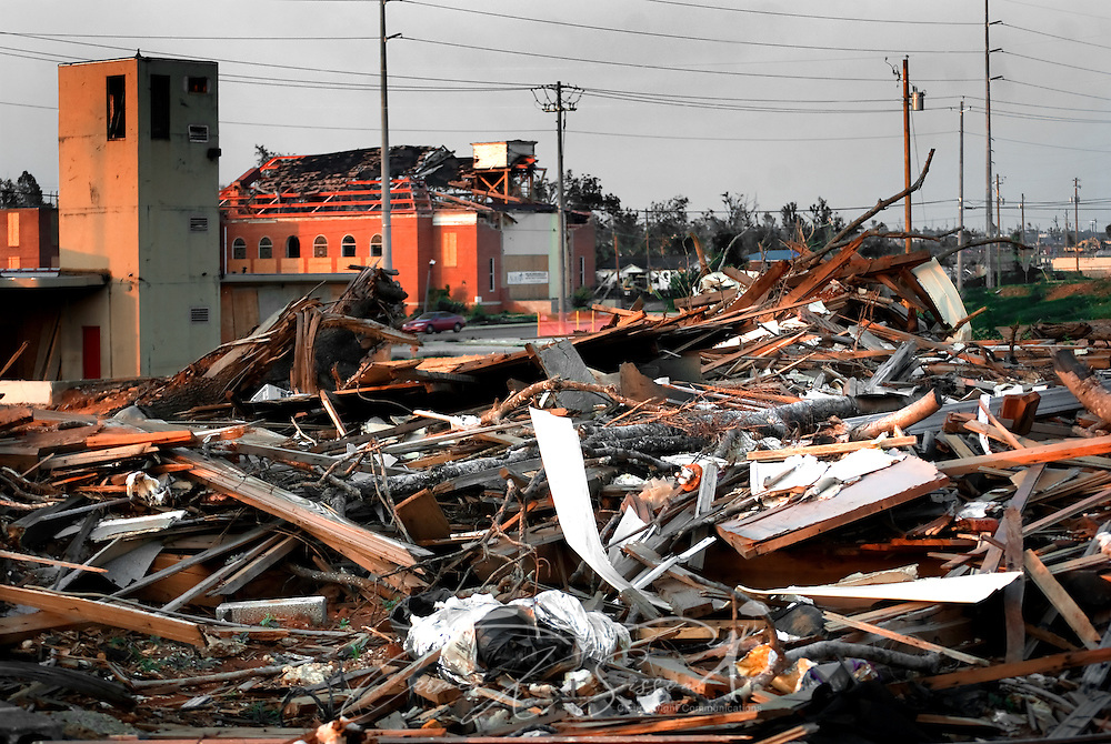 A home, destroyed by the April 27 tornado, stands in front of a heavily damaged church in Alberta City July 26, 2011 in Tuscaloosa, Ala. More than 43 people died, and more than 7,000 buildings were destroyed, when the F-5 tornado roared through the area. (Photo by Carmen K. Sisson/Cloudybright)