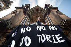 "© Licensed to London News Pictures. 31/08/2019. Manchester, UK. A man raises a banner reading "" No no no no no no tories"" on the Albert Memorial at a pro-EU demo at Albert Square in Manchester City Centre , as objections are raised to the Prime Minister Boris Johnson's intention to prorogue Parliament in the run up to Britain's planned Brexit deadline . Photo credit: Joel Goodman/LNP"