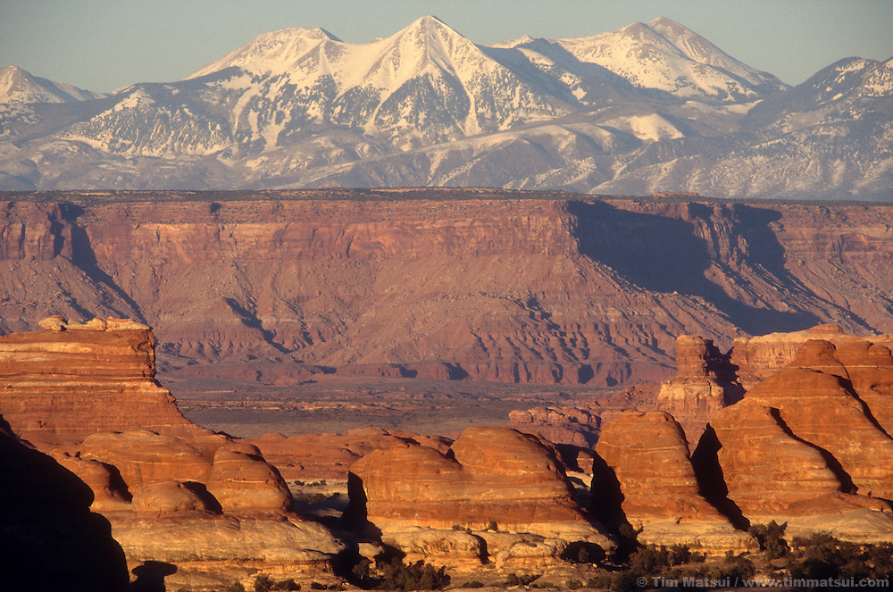 The La Sal range rises over Canyonlands National Park and Lockhart Basin.