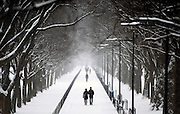 A couple walks in the snow on the National Mall in Washington, D.C. after an overnight storm crippled the metro region with over 20 inches of snow.