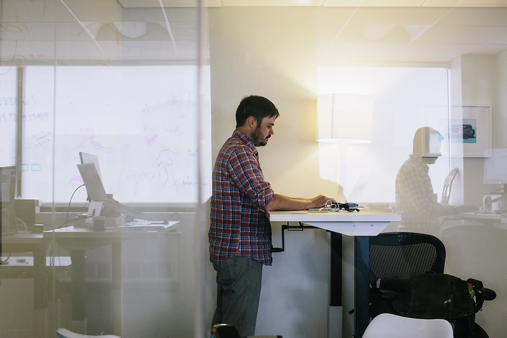 An employee at VOX Media, works at his office in Washington DC.