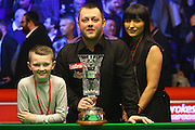Mark Allen with the trophy and family after winning the Snooker Players Championship Final at EventCity, Manchester, United Kingdom on 27 March 2016. Photo by Pete Burns.