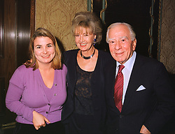 Left to right, the HON.MRS CAPSTICK-DALE and her parents LORD & LADY RAYNE, at a party in London on 13th November 1998.MLY 14