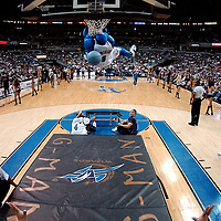 10 March 2007:   The Washington Wizards mascot G-Wiz performs for crowd with high flying slam dunk during a break in the action  against the New York Knicks at the Verizon Center in Washington, D.C.  The Knicks defeated the Wizards 90-89.