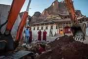 Buddhist monks supervise an infrastructral repair at Rabgya monestary in Golok region, Tibet (Qinghai, China). The monestary is home to around 500 monks of the Gelukpa sect.