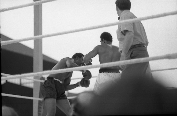 Ali vs Lewis Fight, Croke Park,Dublin..1972..19.07.1972..07.19.1972..19th July 1972..As part of his built up for a World Championship attempt against the current champion, 'Smokin' Joe Frazier,Muhammad Ali fought Al 'Blue' Lewis at Croke Park,Dublin,Ireland. Muhammad Ali won the fight with a TKO when the fight was stopped in the eleventh round...Image of Ali as he drives Lewis back onto the ropes in this onslaught.